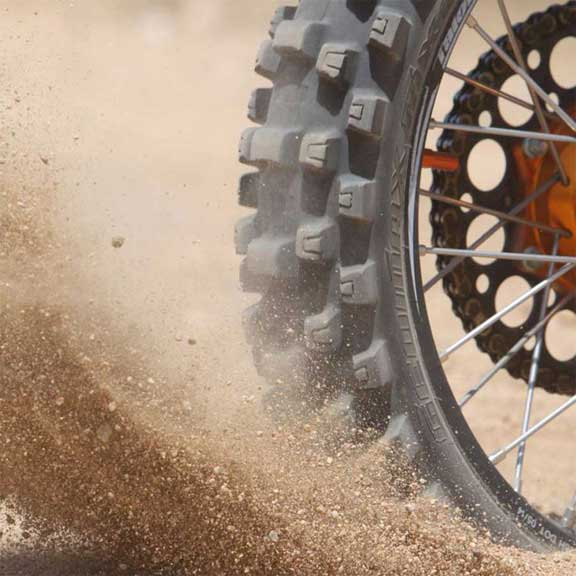 motorcycle tire spinning in dirt